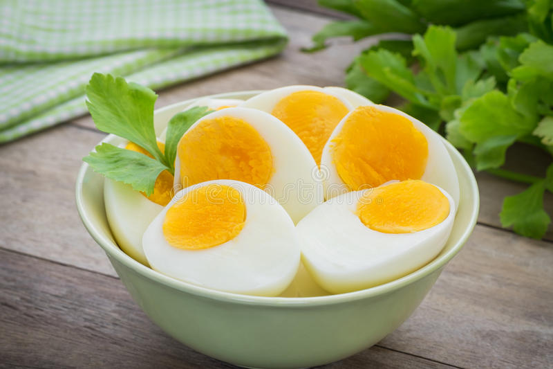 Boiled eggs in bowl stock photos
