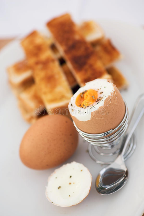 Boiled eggs for breakfast. Boiled eggs & toast'soldiers' - shallow dof stock images