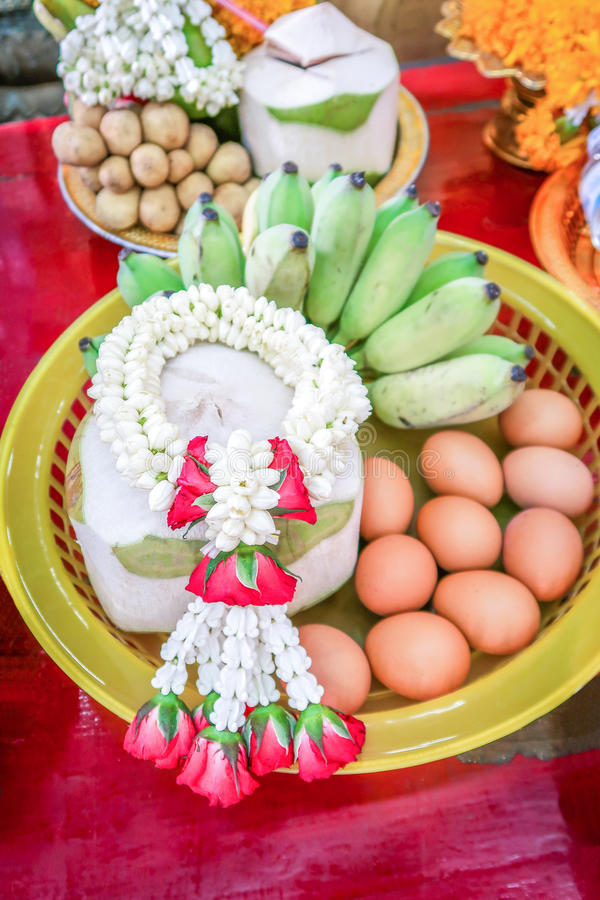 Boiled eggs coconut and banana to oblation vow, traditional ceremony in Thailand. Boiled eggs coconut and banana in basket to oblation vow, traditional ceremony royalty free stock photos