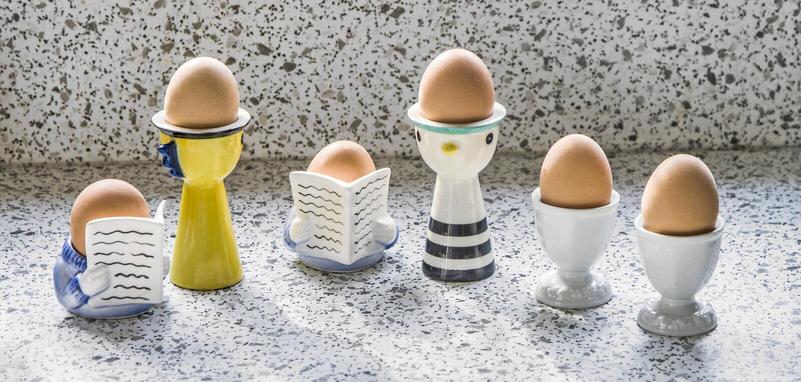 Boiled eggs in egg cups stock image