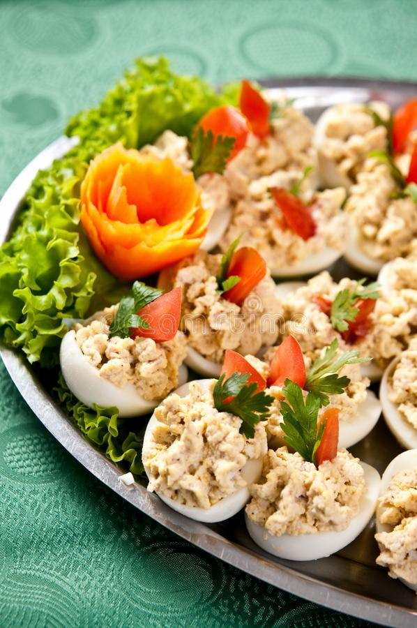 Boiled eggs with fish cream topping stock photos