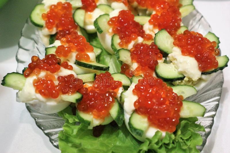 Boiled eggs with red caviar royalty free stock photo