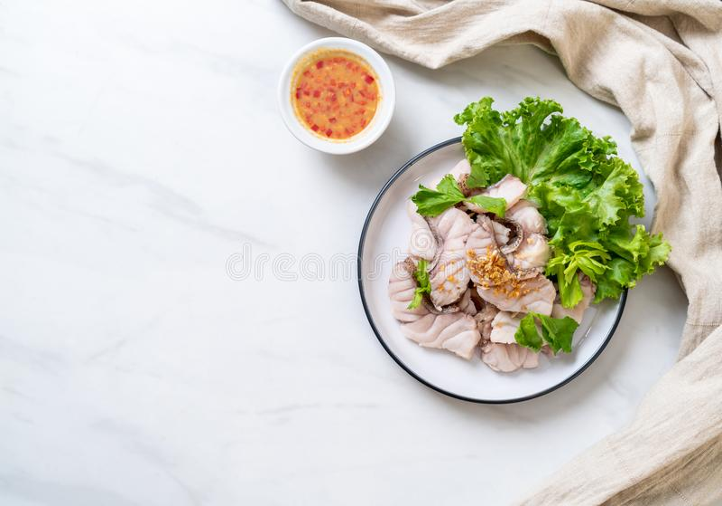 Boiled fish dip with sauce stock photos