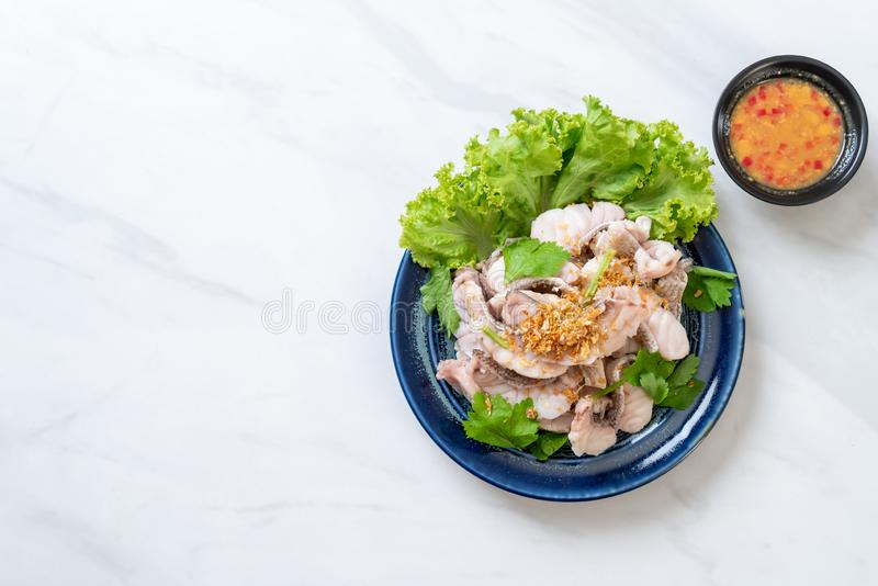 Boiled fish dip with sauce stock photography
