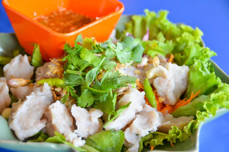 Boiled fish meatball with Thai style hot and spicy seafood sauce dip. royalty free stock image
