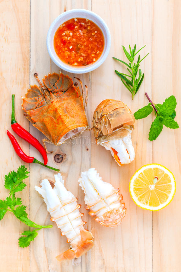 Free Boiled Flathead Lobster, Lobster Moreton Bay Bug, Oriental Flathead Lobster With Herbs And Spices Sauce On Wooden Background. Royalty Free Stock Photography - 61580227