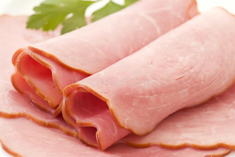 Boiled gammon. Slices rolls as closeup royalty free stock image