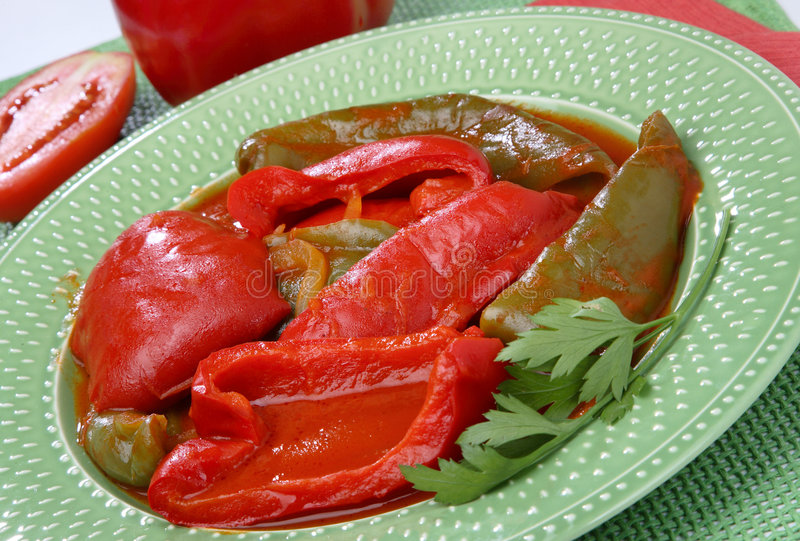 Boiled green and red peppers royalty free stock image