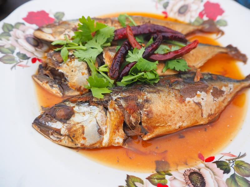 Boiled mackerel fish in a sweet sauce. Thai cuisine in the restaurant royalty free stock photography