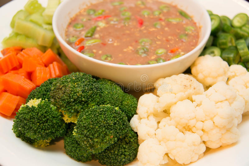 Boiled mixed vegetables and chili dip royalty free stock images