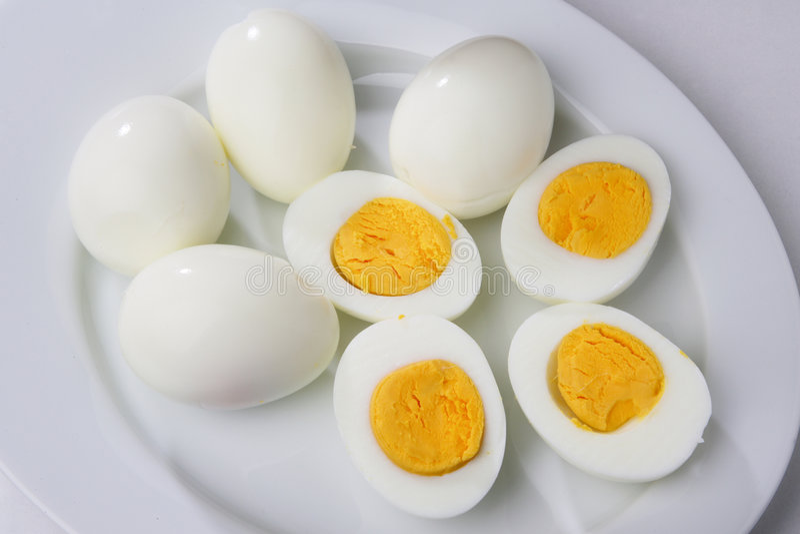 Boiled peeled eggs stock photos