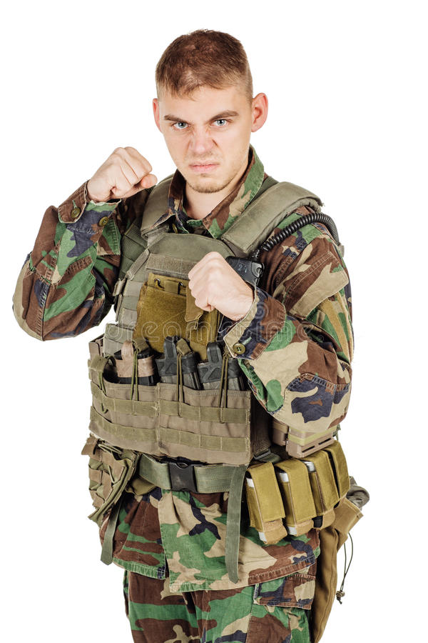 Portrait soldier or private military contractors showing fist and ready fighting . stock image