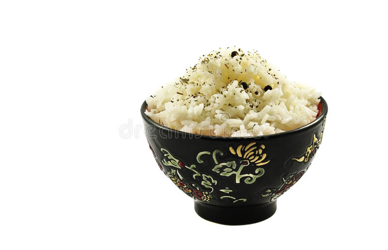 Boiled rice in ceramic ware. Isolated on the white royalty free stock photography