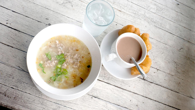 Boiled rice with Minced pork Thai Breakfast on white wood antique stock image