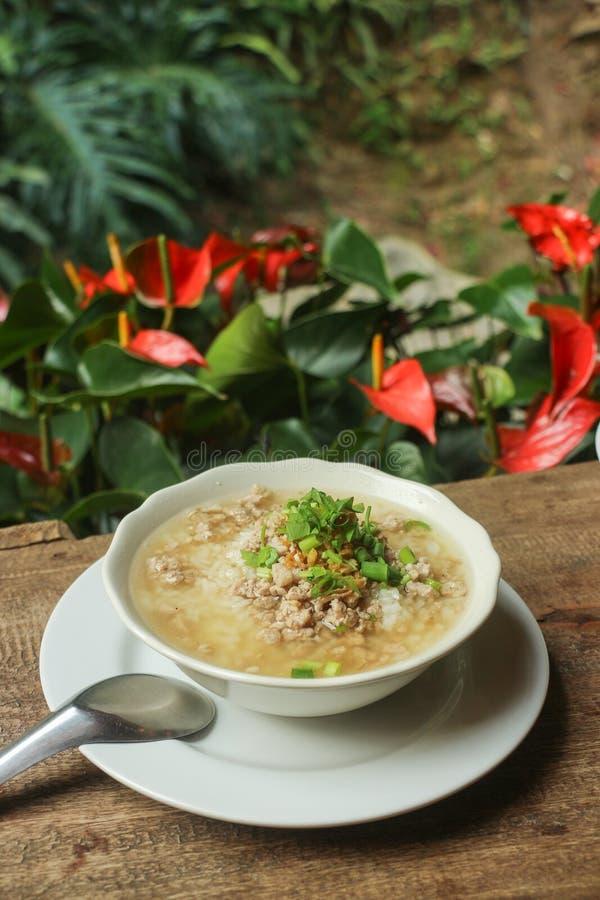 Boiled rice pork or mush - Thai style breakfast royalty free stock image