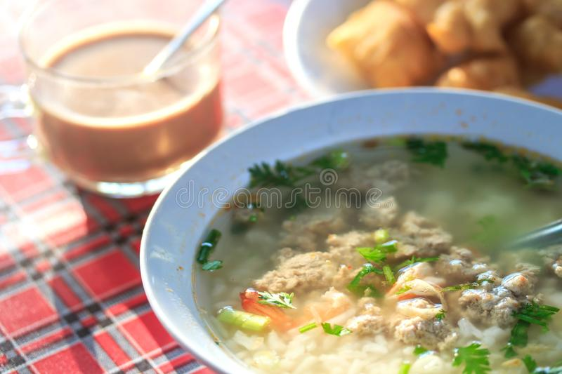 Boiled rice pork and shrimp or mush morning with coffee and deep-fried dough stick stock images
