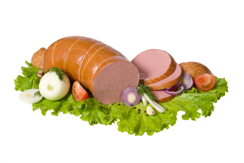 Boiled sausage decorated with vegetables royalty free stock images