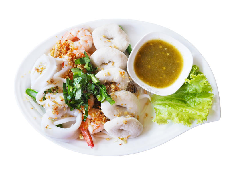 Boiled seafood dip with hot and sour sauce on white plate isolat royalty free stock photography