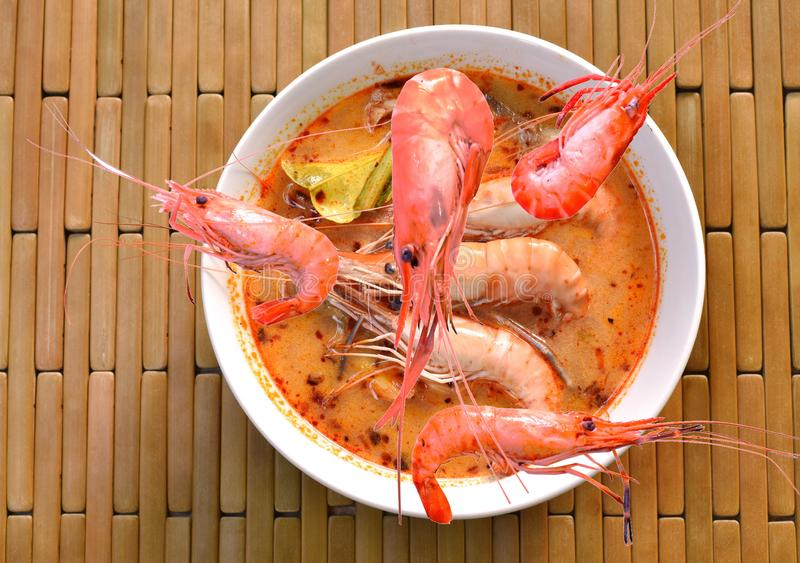 Boiled shrimp falling in Thai spicy soup or tom yum kung on bowl stock images
