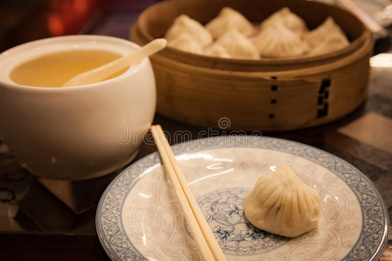 Boiled small dumplings with pork in the Chinese restaurant.  royalty free stock image