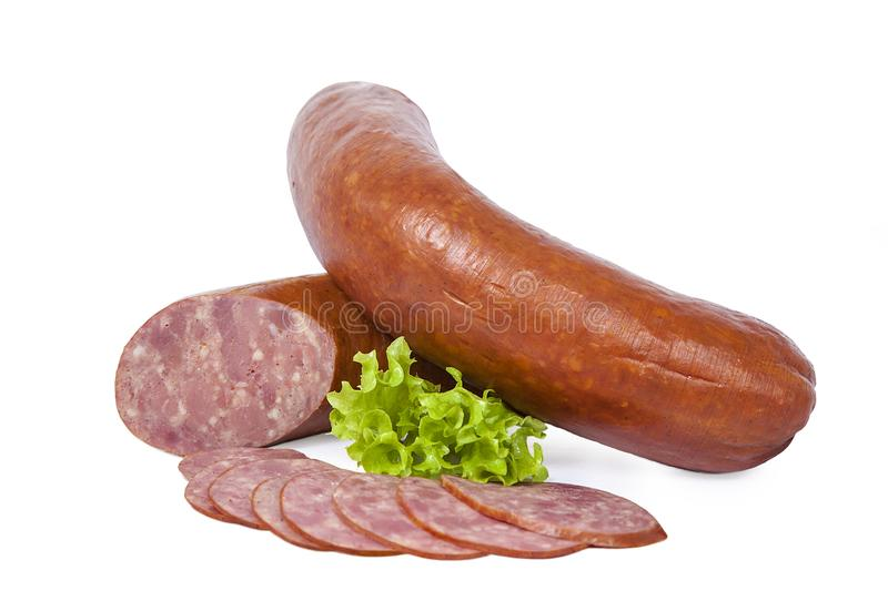 Boiled smoked sausage whole and partially sliced. Isolated on white background royalty free stock image