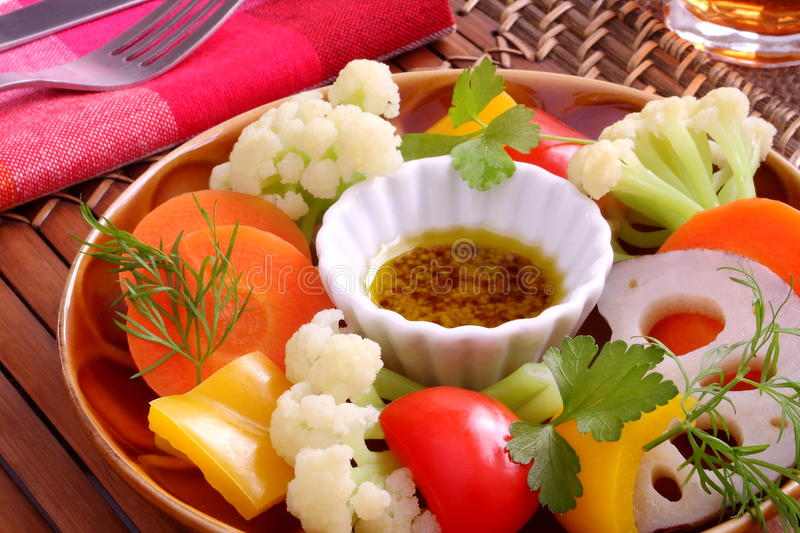 Hot salad, boiled vegetable, Bagna cauda. Boiled vegetables with the seasoned olive oil royalty free stock photography