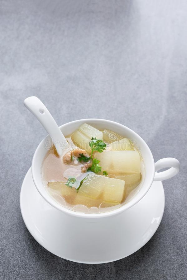 Boiled winter melon soup with chicken rib in white bowl on table stock photo