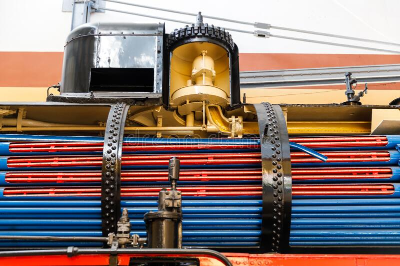 Boiler and chimneys in steam train, detail of mechanism a vintage russian steam train locomotive stock photo