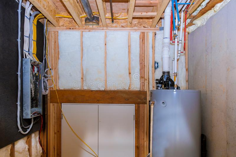 Boiler and pipes of the heating system a home framing with basement, control panel with wiring terminals in the electrical royalty free stock photography