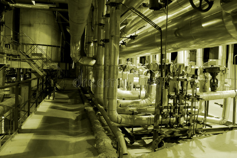 Boilers, ladders and pipes royalty free stock photo