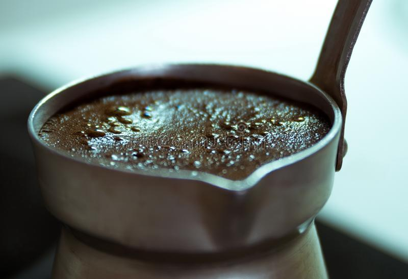 Boiling black coffee macro. Closeup royalty free stock image