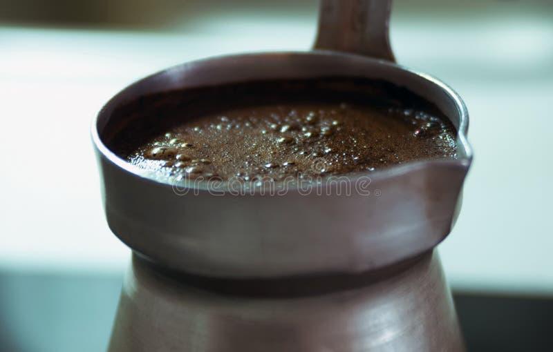 Boiling black coffee. Macro closeup stock photos