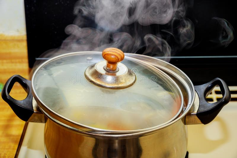 Close up boiling pork and chicken soup or boiled water in hot in pot boiling food. Boiling chicken and pork rip soup or boiled water in hot in pot boiling food stock photography