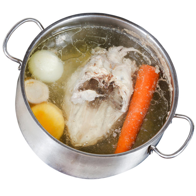 Boiling of chicken soup isolated on white stock photography