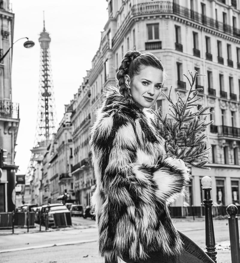 Portrait of trendy woman with Christmas tree in Paris, France. Boiling hot trendy winter in Paris. Portrait of trendy woman with Christmas tree in Paris, France royalty free stock photography