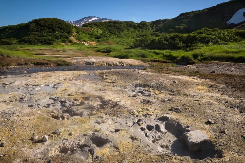 Boiling mud pots and hotsprings on the slopes of Mutnovsky volcano near the geothermal power plant. Kamchatka, Russia stock photo