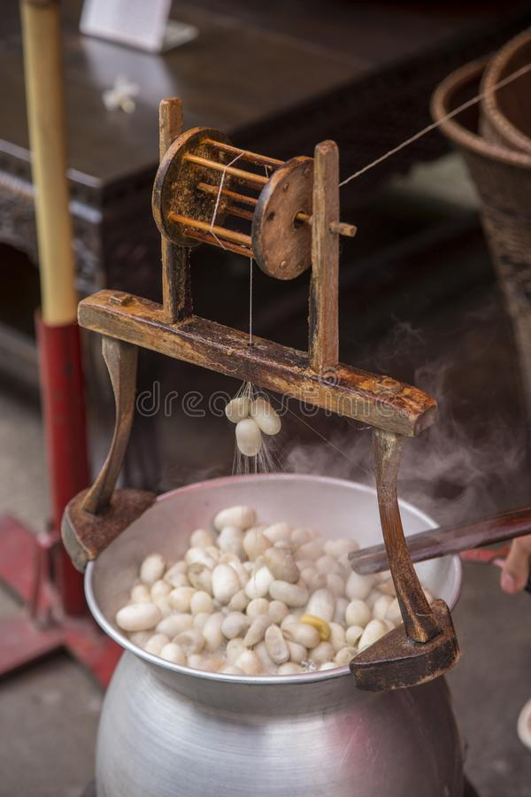 Boiling silkworm cocoon in pot. To conversion raw silk royalty free stock images