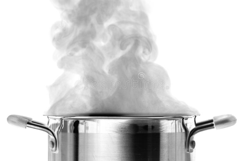 Boiling water. In a saucepan over white background royalty free stock photos