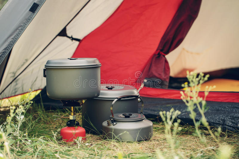 Boiling water in kettle on portable camping stove royalty free stock image
