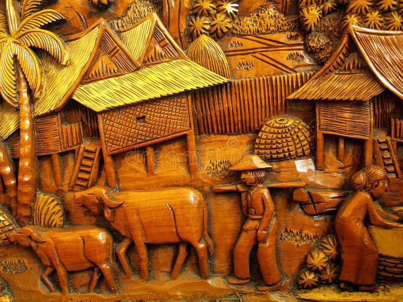 Bois découpant au sujet de l'agriculteur traditionnel thaïlandais photos stock
