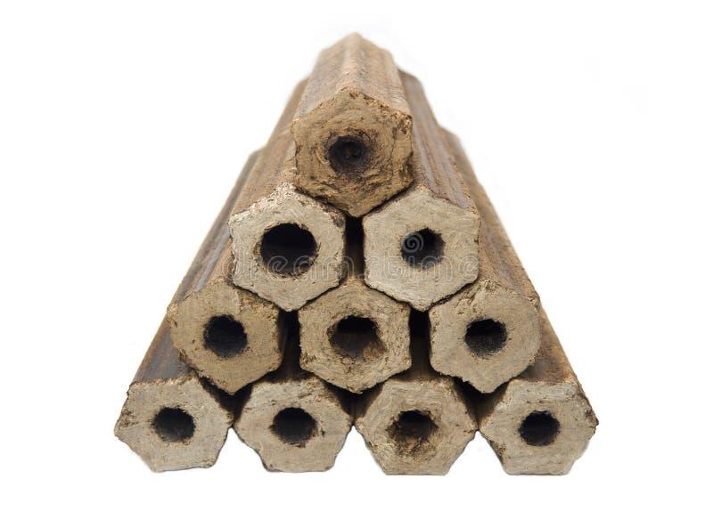 Bois de chauffage de sciure pressée sous forme de forme hexagonale de cylindres creux images stock