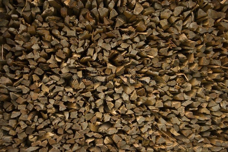 Bois de chauffage - morceaux de bois de teck, fond photos libres de droits