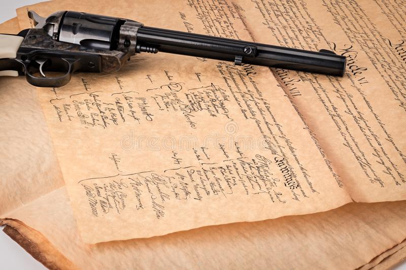 Classic handgun on a copy of the constitution contract with Amer stock photo