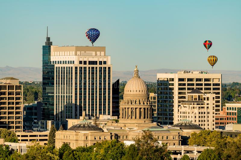 Red white and Blue hot air balloon over state capitol building royalty free stock photos
