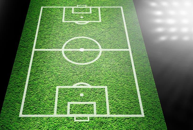 Boisko piłkarskie w światłach reflektorów obrazy stock