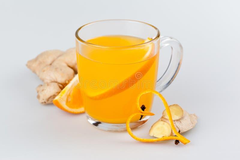Boisson chaude de gingembre orange photographie stock libre de droits
