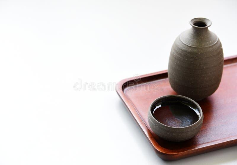 Boisson orientale de saké japonais photographie stock