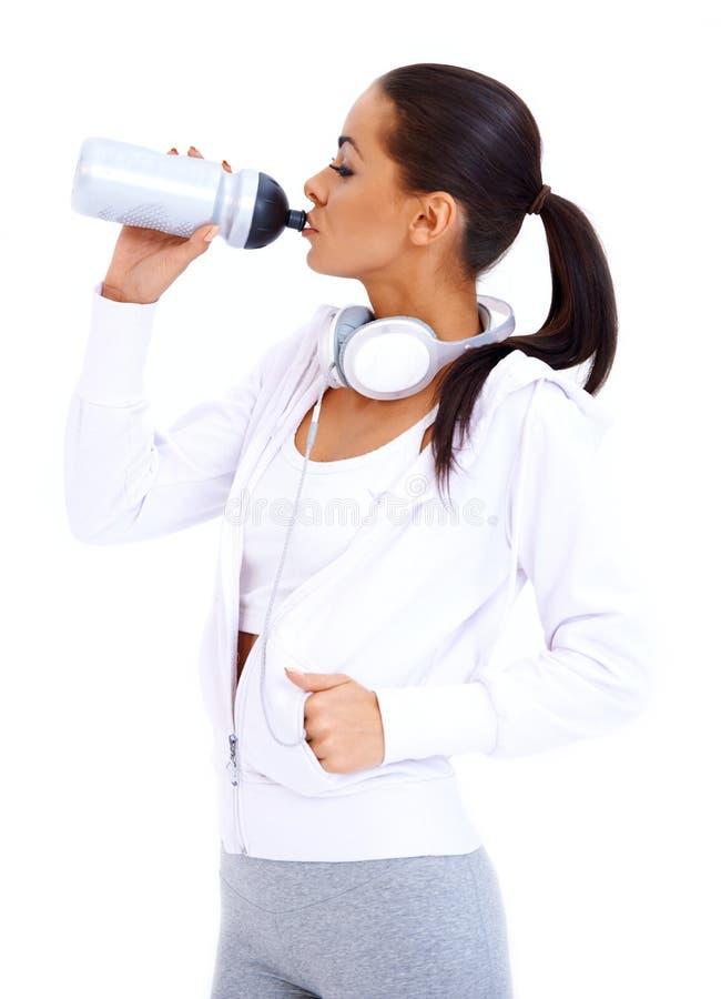 Boissons sportives de femme de bouteille de forme physique images stock