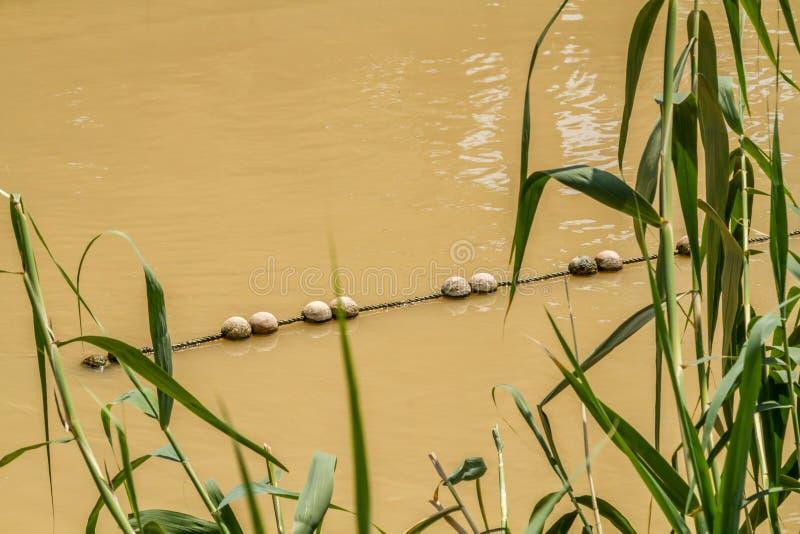 Bojen auf Jordan River in Qasr EL Yahud, Israel stockfotografie
