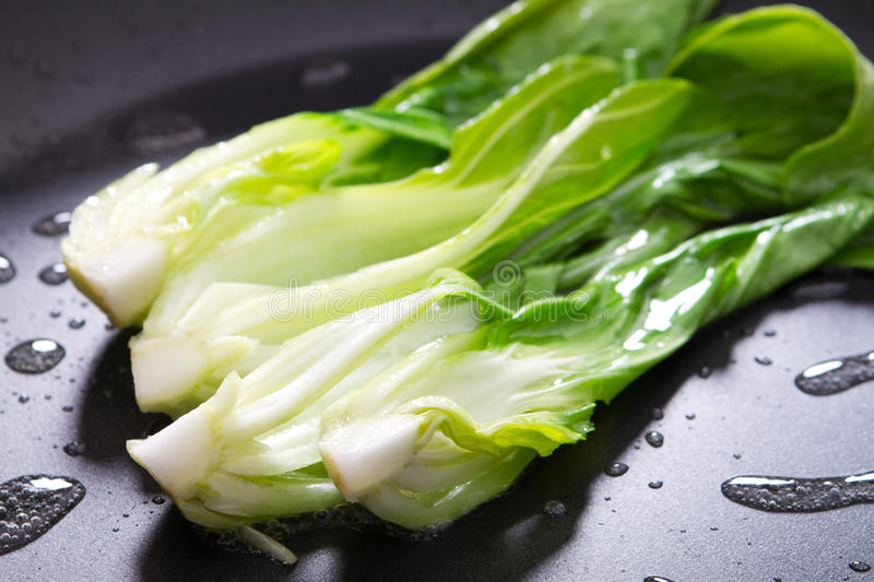 Bok choy. Stir fry in pan stock photography